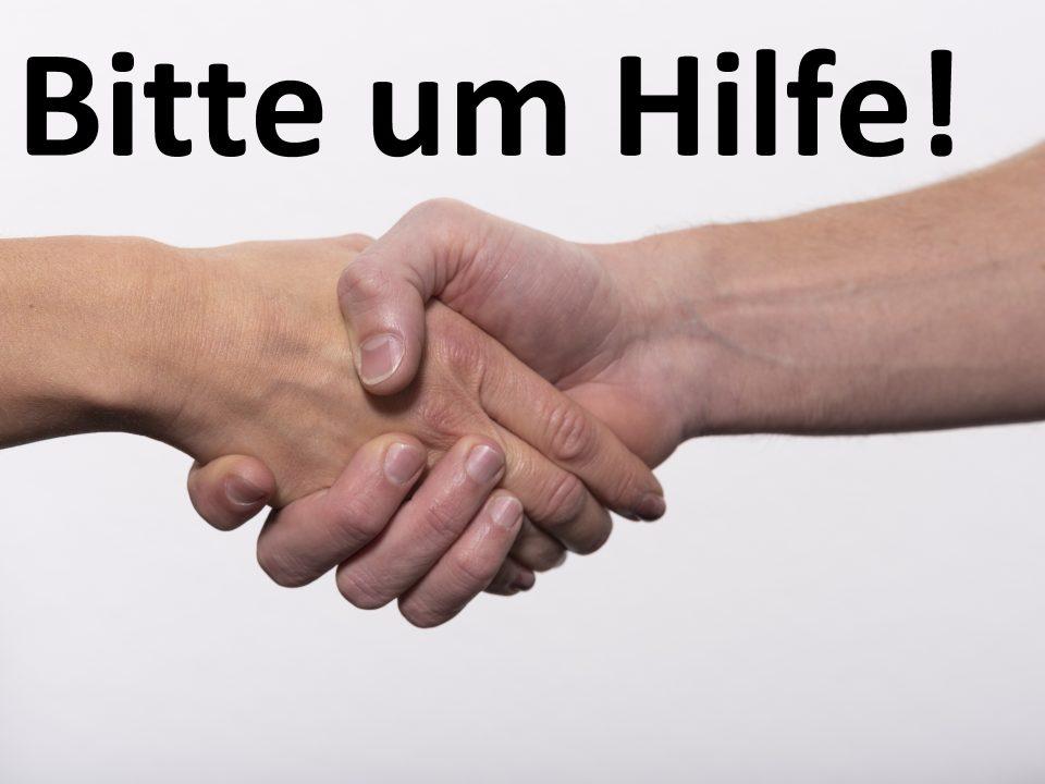 Zwei Hände schütteln sich und bitten gegenseitige Hilfe